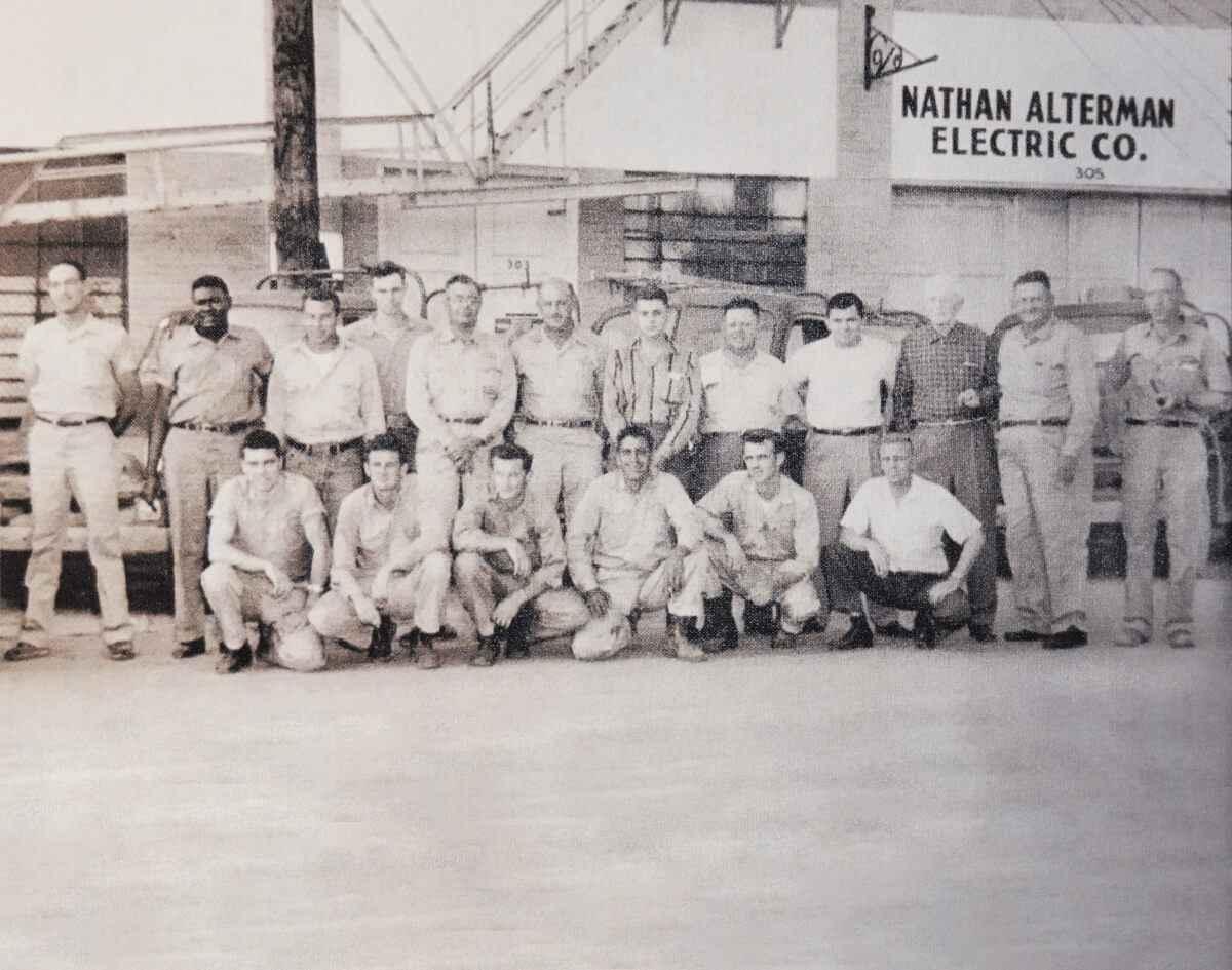 Black and white picture of Alterman team from when the company began.